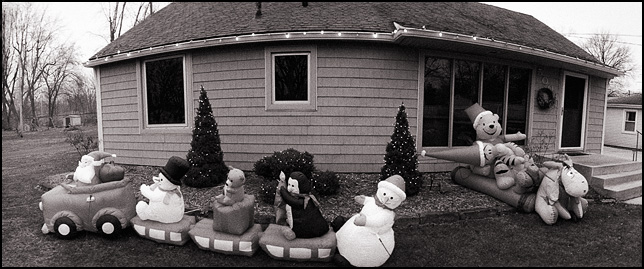 Panoramic photo of inflatable Christmas decorations in front of a house in Fort Wayne, Indiana.