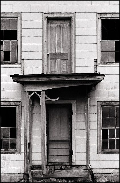 Front door of an abandoned farmhouse in rural Noble County, Indiana.