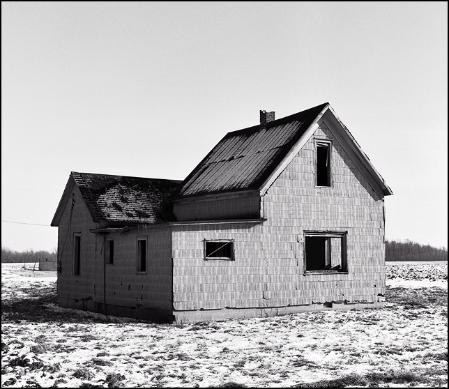abandoned farm house in huntington county, indiana near interstate 69 in winter with snow on the ground. county road 900s.