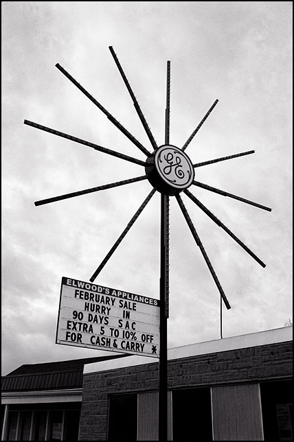 The starburst shaped General Electric sign outside Elwoods Appliances in the Waynedale area of Fort Wayne, Indiana. The sign has hundreds of tiny bulbs radiating out from the center with a lighted GE logo.