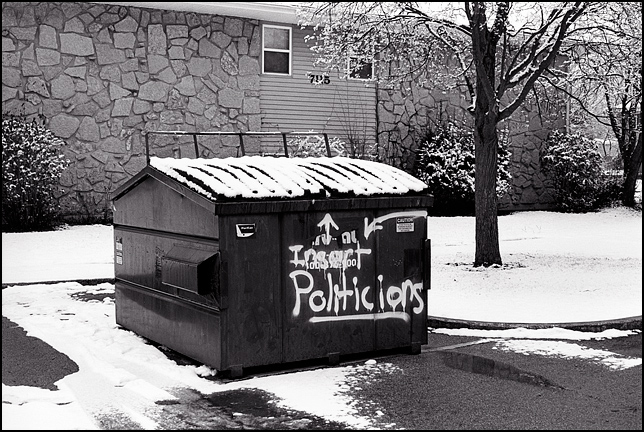 "A dumpster at Hickory Creek Apartments in Waynedale. Vandals have spray painted ""Insert Politicians"" on it as a political protest."