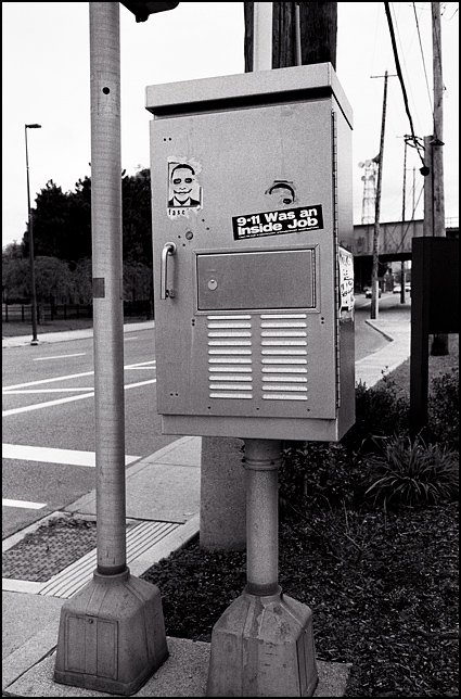 A bumper sticker that says 9-11 was an inside job is stuck to a traffic light control box in downtown Fort Wayne, Indiana at the corner of Lafayette and Superior Streets. A couple of the Obama Joker stickers that call President Obama a Fascist are also stuck there.